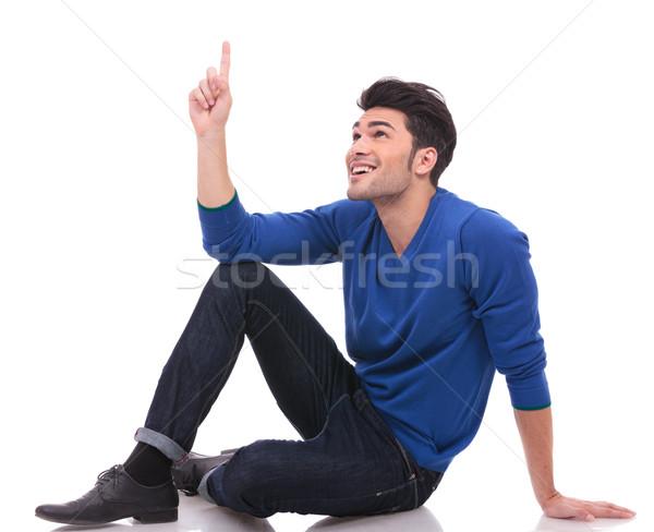 сидящий человека указывая что-то вверх молодые Сток-фото © feedough