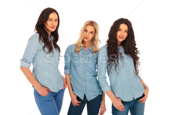 three fashion models in blues jeans clothes Stock photo © feedough