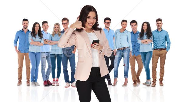 Femme d'affaires leader téléphone appel groupe chef d'équipe Photo stock © feedough