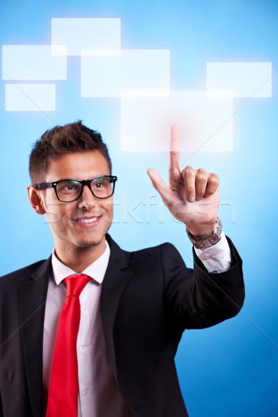 Stock photo: business man pressing a touchscreen button