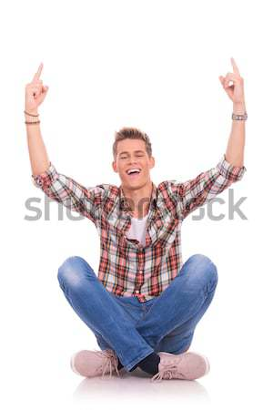 cheerful seated young man Stock photo © feedough