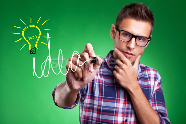casual man wrtiting Idea and light bulb Stock photo © feedough
