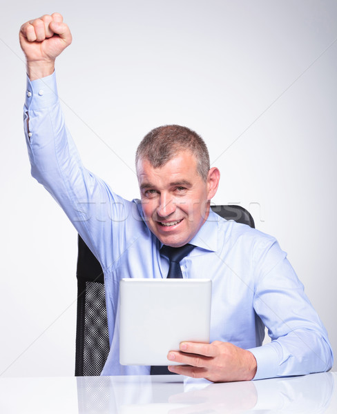old business man with tablet cheers Stock photo © feedough