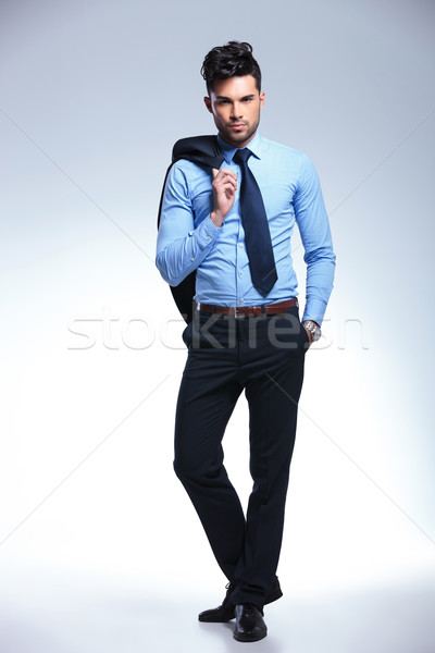 business man stands with jacket on shoulder Stock photo © feedough