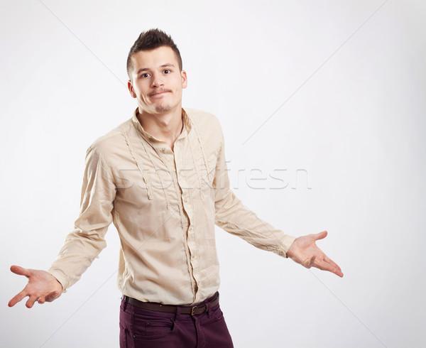 Kép határozatlan fiatal lezser férfi stúdió Stock fotó © feedough