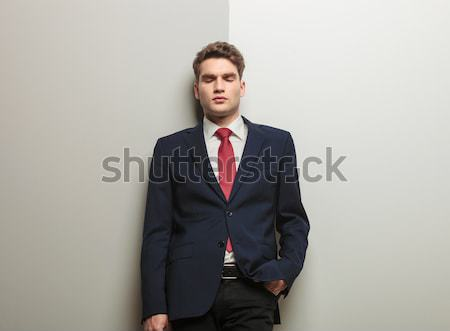 business man leaning on a grey wall  Stock photo © feedough