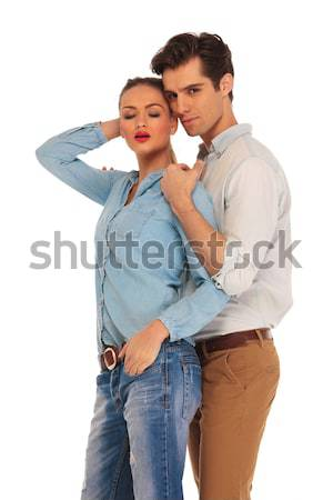 woman in green dress leaning elbow on man's shoulder Stock photo © feedough