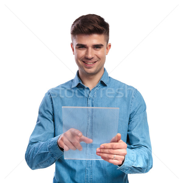young casual student working on a futuristic transparent touchsc Stock photo © feedough