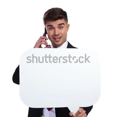 shocked businessman speaking on the phone while holding speech b Stock photo © feedough