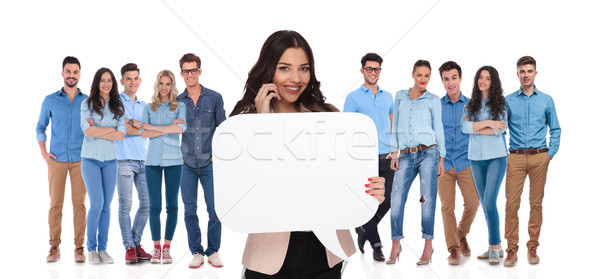 businesswoman team leader holds bubble speech while talking on p Stock photo © feedough