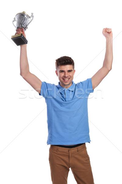 Boldog férfi tart trófea csésze kezek Stock fotó © feedough