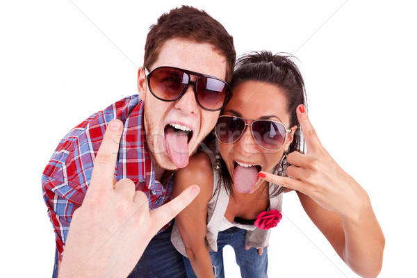 Stock photo: party couple screaming with tongues out