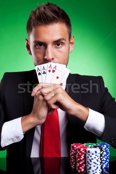card player covering his mouth with four aces Stock photo © feedough