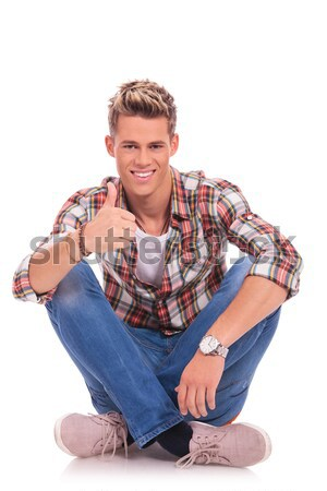 young man sitting with legs crossed Stock photo © feedough