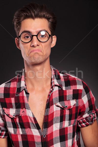 Stock photo: ignorant casual man wearing glasses