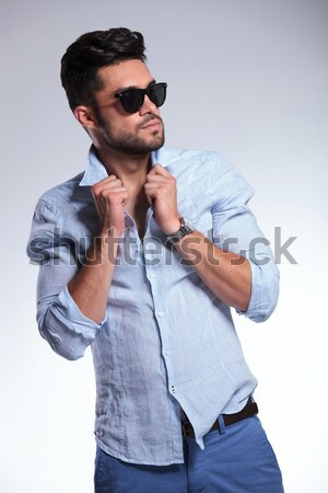 casual man looks away with jacket over shoulder Stock photo © feedough