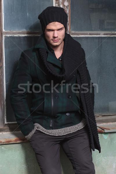 young fashion man on window sill Stock photo © feedough