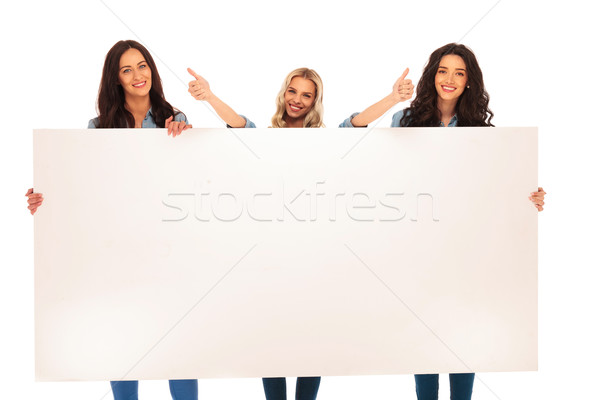 3  women recommend what they  show you on  big  board Stock photo © feedough