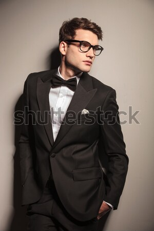 suspicious young business man wearing glasses Stock photo © feedough