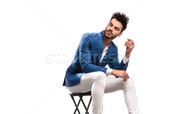 seated elegant man looks back over his shoulder  Stock photo © feedough