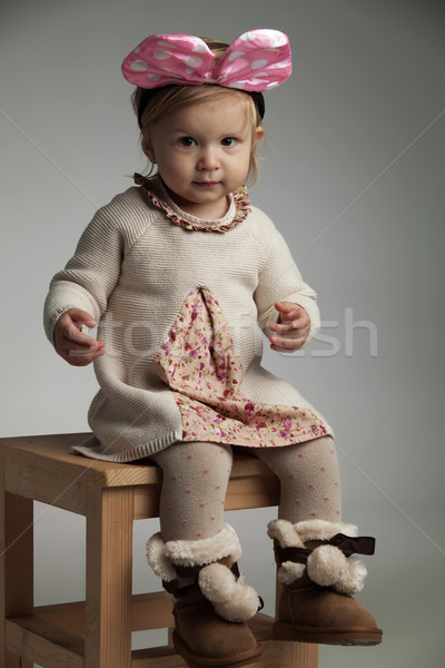 girl wears knitted dress, furry boots and pink bow headband  Stock photo © feedough