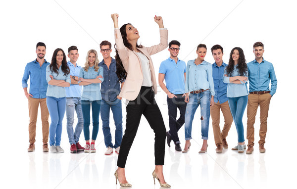 excited businesswoman celebrating while standing in front of her Stock photo © feedough