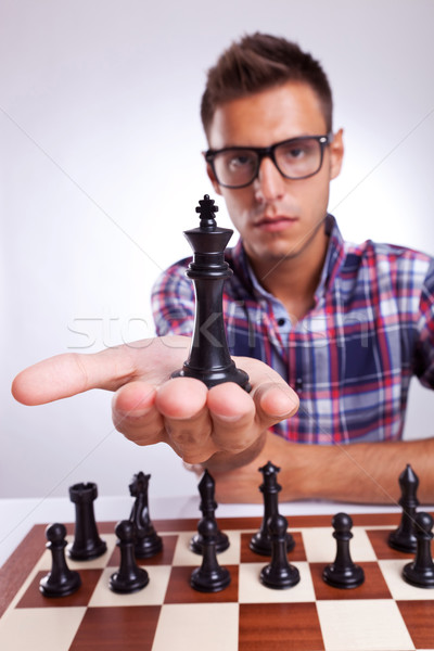 young man chess player holding up his king Stock photo © feedough