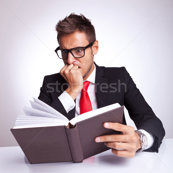 business man being affraid by the action of the book Stock photo © feedough