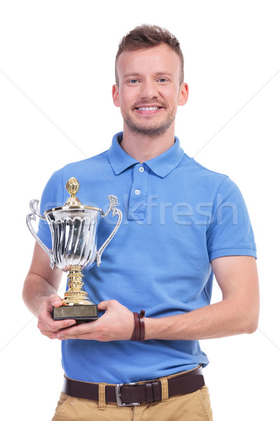 casual young man with trophy in hands Stock photo © feedough