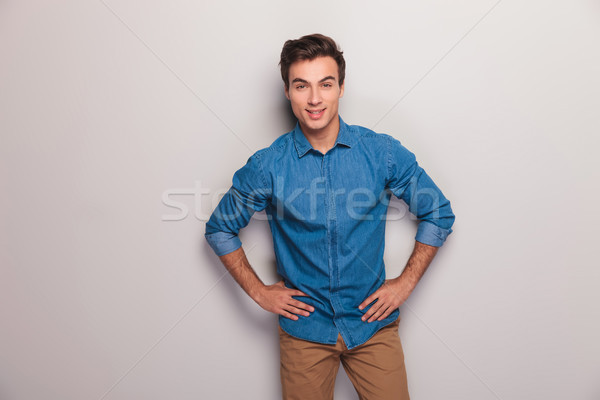 happy casual man with hands on hips Stock photo © feedough