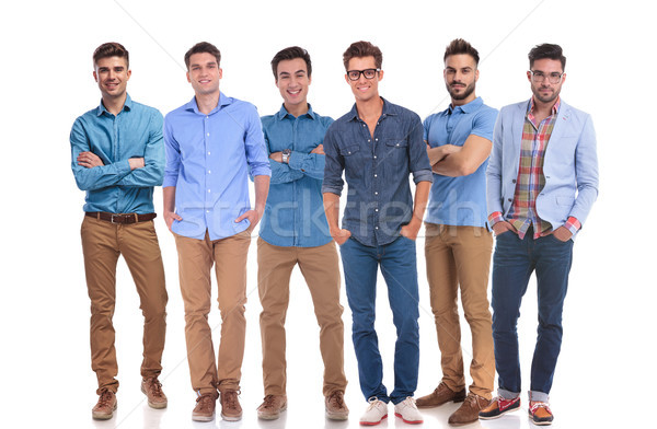 group of six young casual men standing confidently Stock photo © feedough