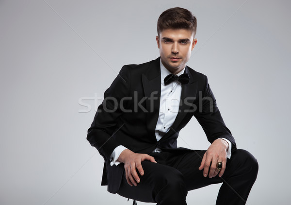portrait of seductive stylish man in tuxedo siting Stock photo © feedough