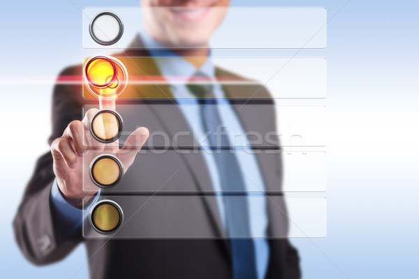 smiling business man choosing and pushing a button Stock photo © feedough