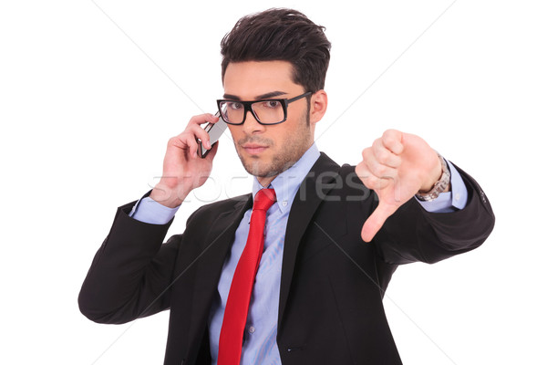business man on phone shows thumb down Stock photo © feedough