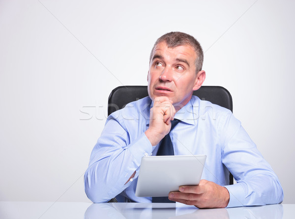 old business man daydreams with tablet in hand Stock photo © feedough