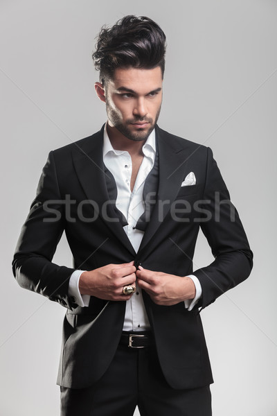 young man wearing tuxedo closing his jacket Stock photo © feedough