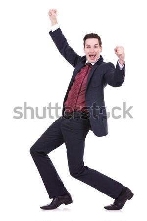 üzletember ugrik kezek levegő boldog fiatal Stock fotó © feedough