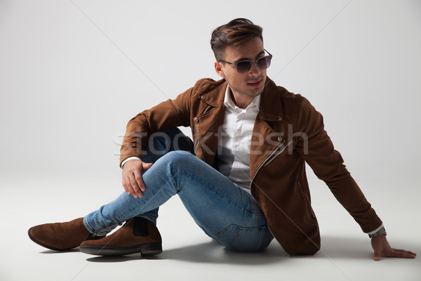 fashion man lying down and looks back over shoulder Stock photo © feedough