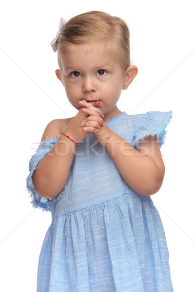 cute little girl prays with palms together  Stock photo © feedough