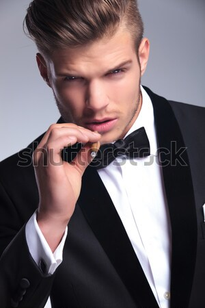 man in tuxedo is thinking with finger on his temple Stock photo © feedough