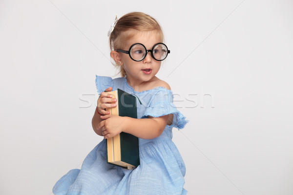 cool nerdy little girl holding her book  Stock photo © feedough