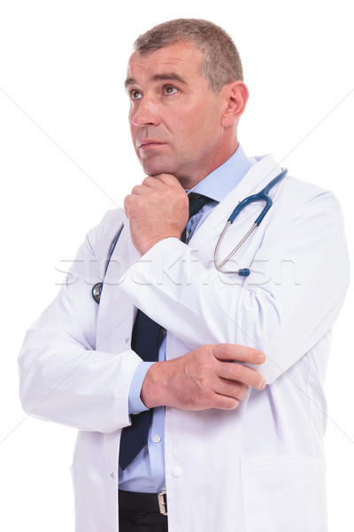 old doctor wondering about the treatment for his pacients Stock photo © feedough