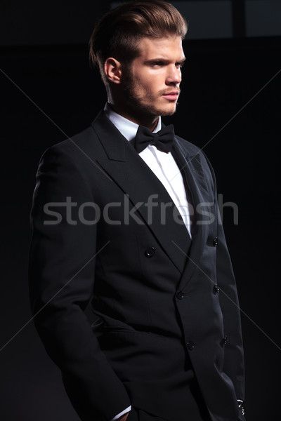 side view of an elegant man with hands in pockets Stock photo © feedough