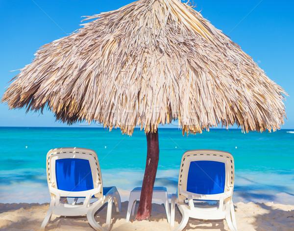 Beach Chairs and Straw Umbrella on the beach Stock photo © feedough
