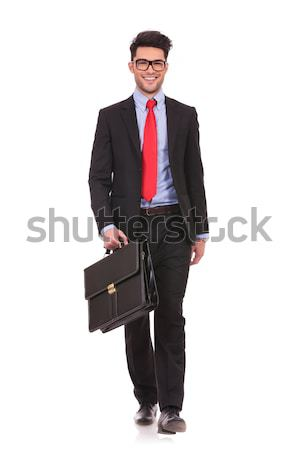 man in suit and tie laughing while walking with briefcase Stock photo © feedough