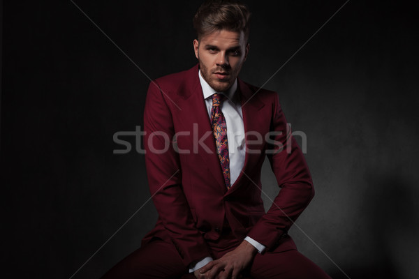 seductive young man wearing grena suit sitting Stock photo © feedough