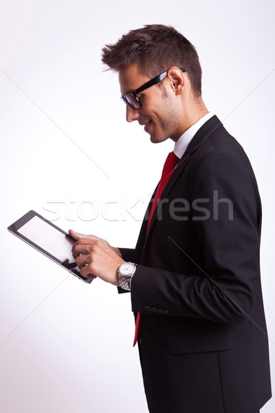 business man browsing on his touch screen pad Stock photo © feedough
