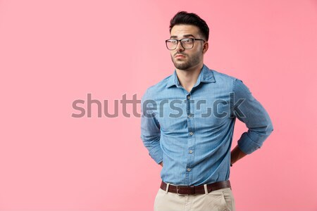 young fashion man with hands in back pockets among bubbles Stock photo © feedough