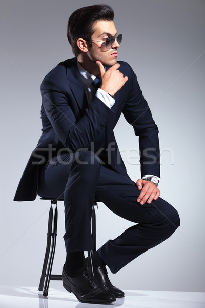 young business man sitting on a stool, thinking Stock photo © feedough