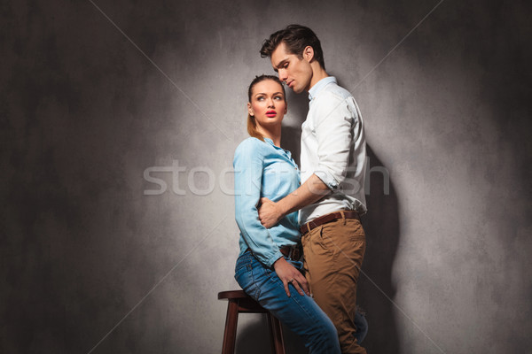 man holding his seated casual girlfriend  Stock photo © feedough